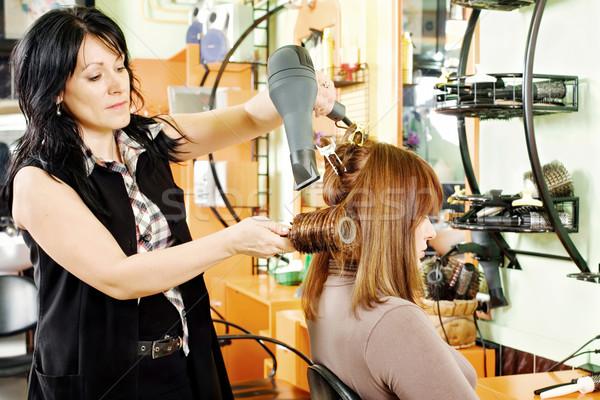 hairdresser drying customer's hair Stock photo © imarin