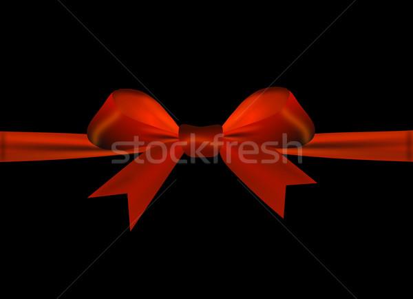 Kırmızı yay yalıtılmış siyah kâğıt parti Stok fotoğraf © impresja26