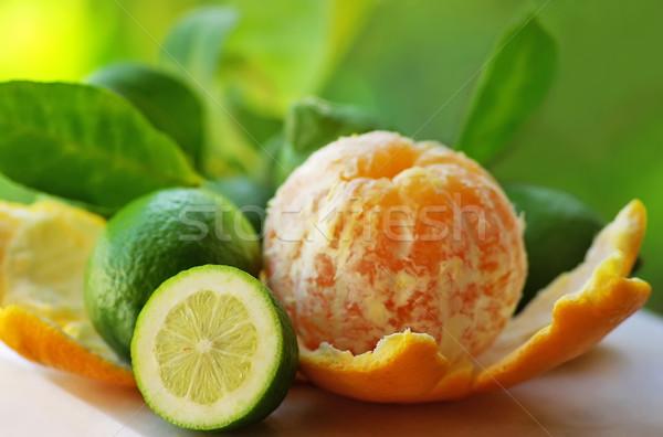 Descascado laranja verde limões comida fundo Foto stock © inaquim