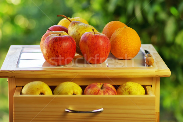 Fruits and knife on table. Stock photo © inaquim