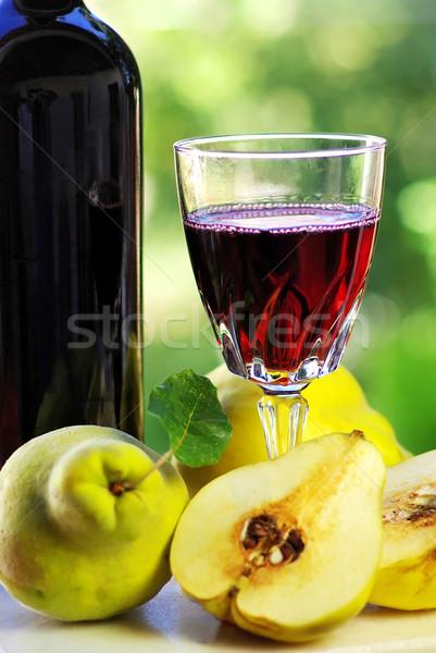 üveg vörösbor birsalma gyümölcsök buli bor Stock fotó © inaquim