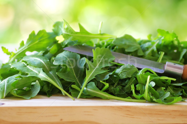 Rucola leaves and knife close-up  Stock photo © inaquim