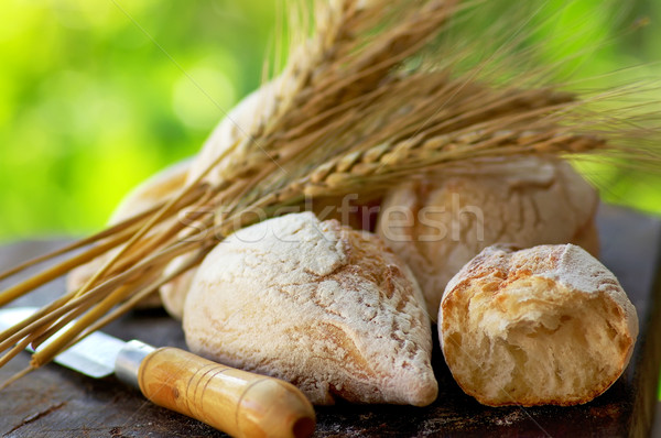 Portuguese bread and spikes of wheat. Stock photo © inaquim