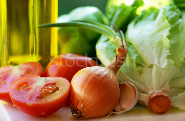 Olive oil and vegetables. Stock photo © inaquim