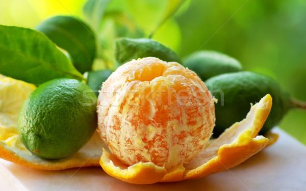 Pelé orange vert citrons alimentaire fond Photo stock © inaquim