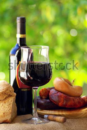 Jamon of spain and red wine. Stock photo © inaquim