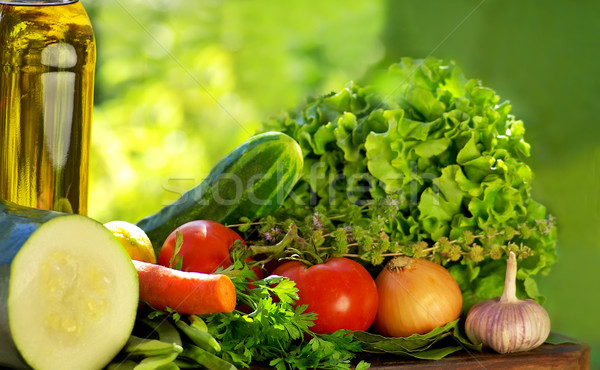 Oliveoil and vegetables on table. Stock photo © inaquim