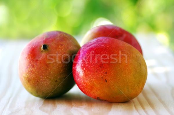 Három gyümölcsök asztal gyümölcs trópusi desszert Stock fotó © inaquim