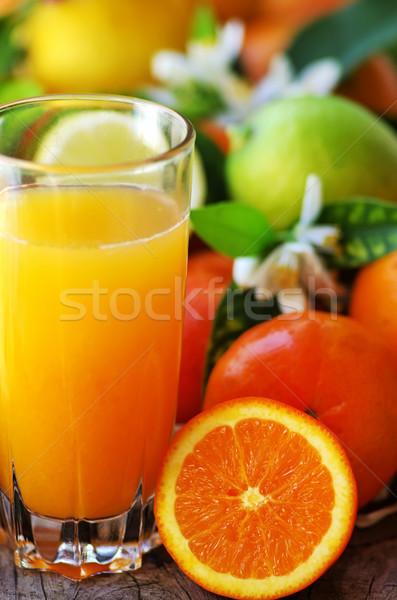 Glass of natural orange juice Stock photo © inaquim