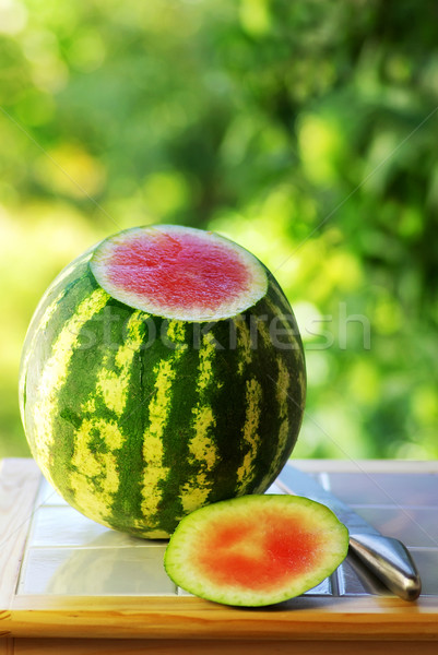 Watermelon and knife on table. Stock photo © inaquim