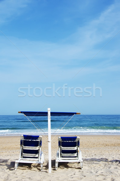 A pair of blue beach chairs in algarve, south of Portugal Stock photo © inaquim