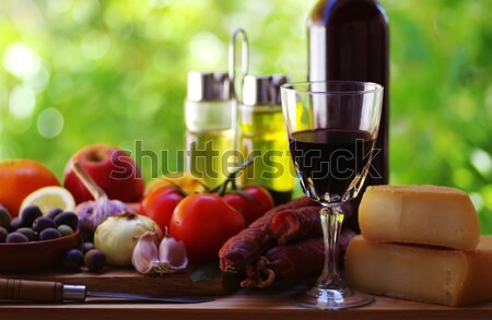 bottle of red wine, a glass of wine and  grapes Stock photo © inaquim