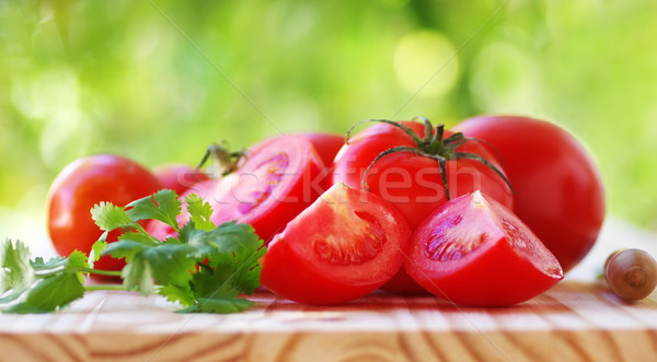 sliced tomatoes  and cilantro on table Stock photo © inaquim