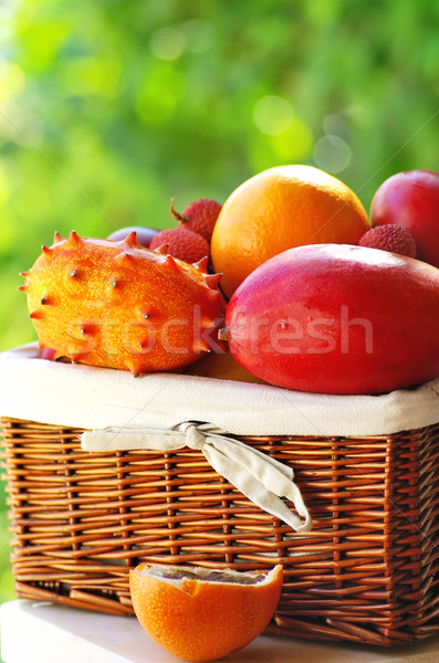 Stock photo: Basket of tropical fruits.