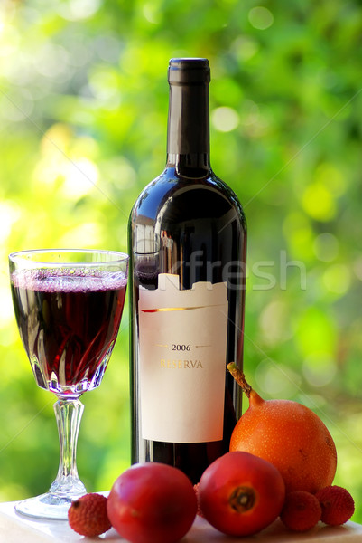 Bottle and glass of red wine. Stock photo © inaquim