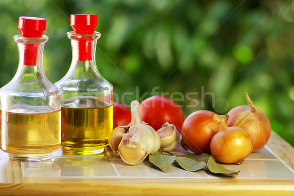 Oliveoil, vinegar and vegetables. Stock photo © inaquim