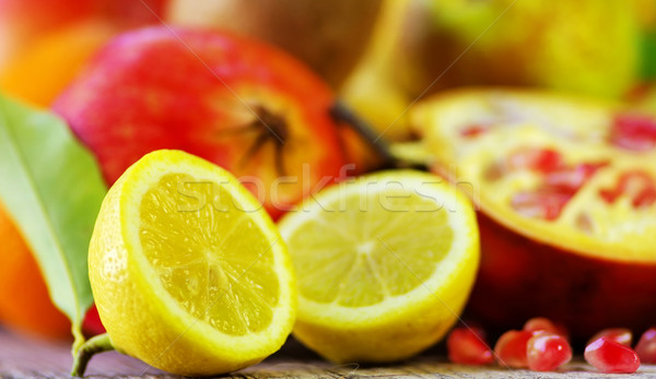 Half Lemon slices and berry of pomegranate Stock photo © inaquim