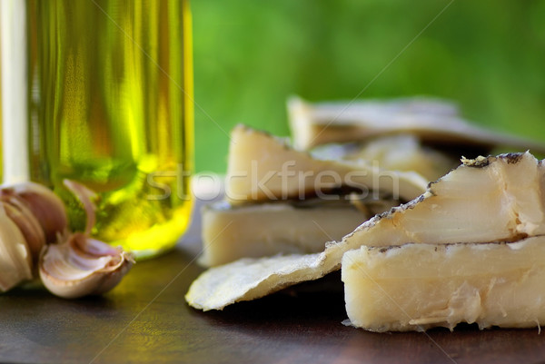 Codfish, oil and garlic. Stock photo © inaquim
