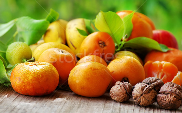 Citrus fruits and walnuts Stock photo © inaquim