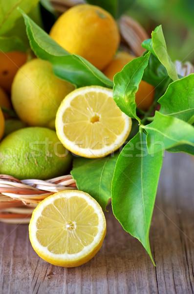 Basket of lemons and half lemons on table Stock photo © inaquim