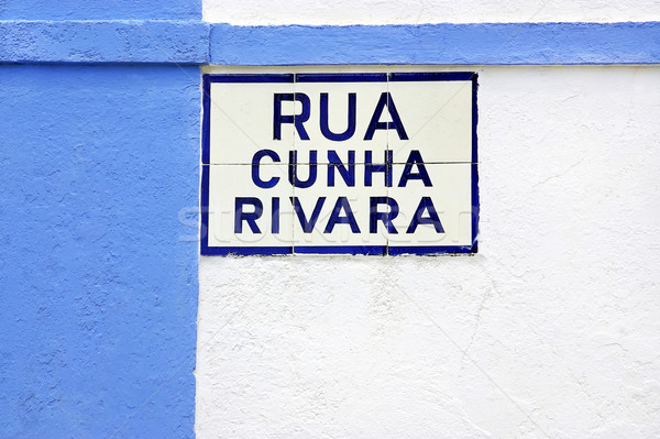 Portuguese tile plaque on blue street Stock photo © inaquim