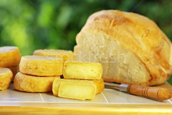 Portuguese cheese, knife and bread. Stock photo © inaquim