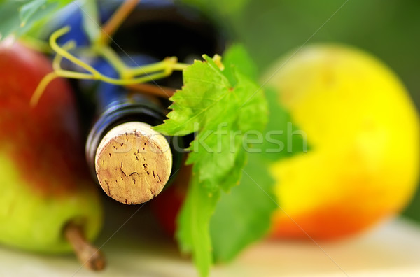 Bottle of wine and fruit with grapevine leves.  Stock photo © inaquim