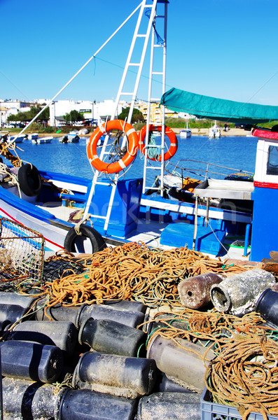 Boat and fishing equipments Stock photo © inaquim