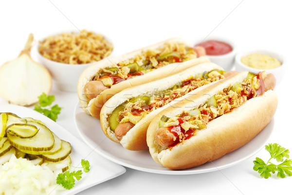 Forró kutyák három hozzávalók tányér edény Stock fotó © IngaNielsen