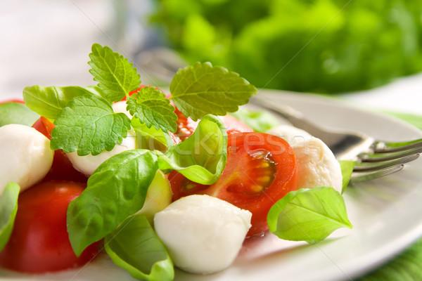 Caprese salatası küçük mozzarella domates fesleğen Stok fotoğraf © IngaNielsen