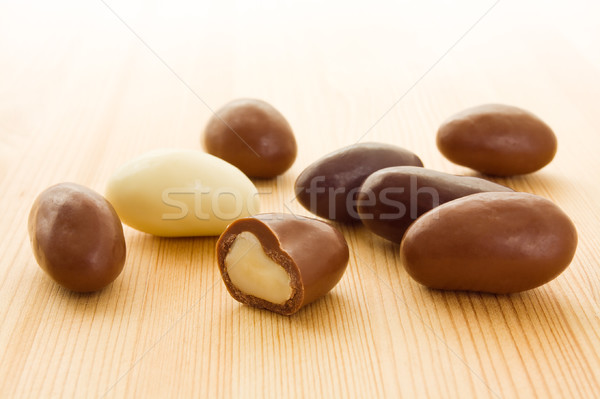 Brazil nuts in chocolate Stock photo © IngaNielsen