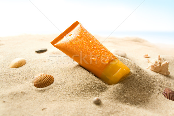 Soleil lotion orange tube sable Photo stock © IngaNielsen