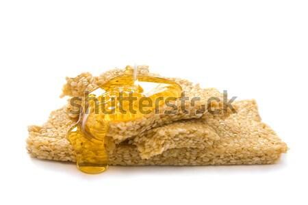 Sésamo miel bar dorado aislado blanco Foto stock © IngaNielsen