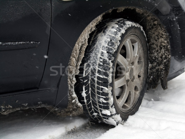 Dirty car tire with snow Stock photo © IngaNielsen