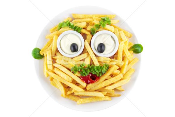 Drôle frites françaises visage mayonnaise ketchup olives Photo stock © IngaNielsen