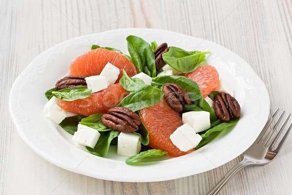 Spenót grapefruit kecskesajt saláta fehér tányér Stock fotó © IngridsI