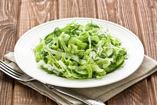 Kool komkommer salade rustiek houten vork Stockfoto © IngridsI