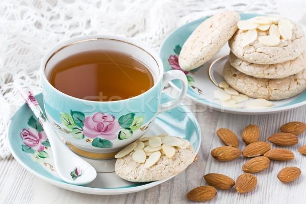 Csésze tea mandula sütik porcelán mandulák Stock fotó © IngridsI