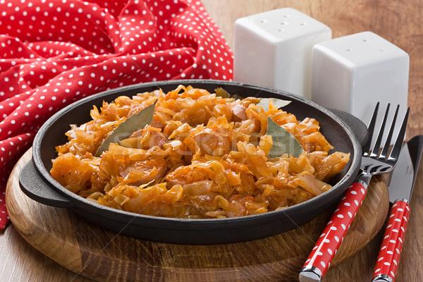 Stewed sauerkraut with sausage  Stock photo © IngridsI