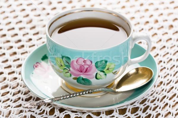 Copo chá colher pires fundo Foto stock © IngridsI