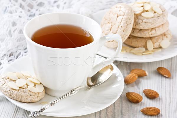 Fehér csésze tea mandula sütik porcelán Stock fotó © IngridsI