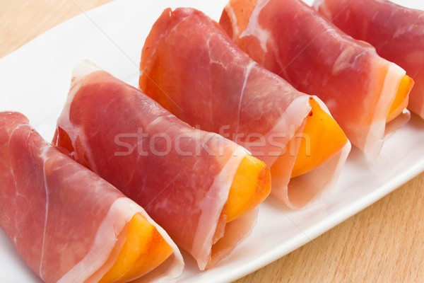 Peach in Prosciutto Stock photo © IngridsI