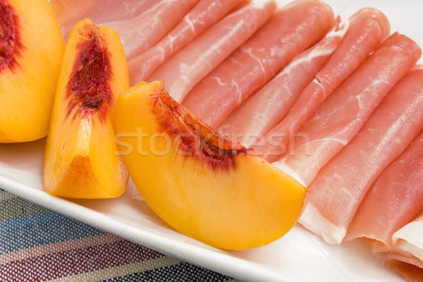Slices of peach and Prosciutto Stock photo © IngridsI