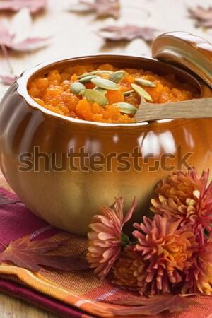 Sütőtök leves kerámia edény fakanál virág Stock fotó © IngridsI