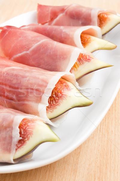 Slices of figs in Prosciutto Stock photo © IngridsI