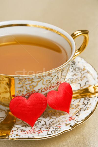 Arany csésze tea antik kettő piros Stock fotó © IngridsI
