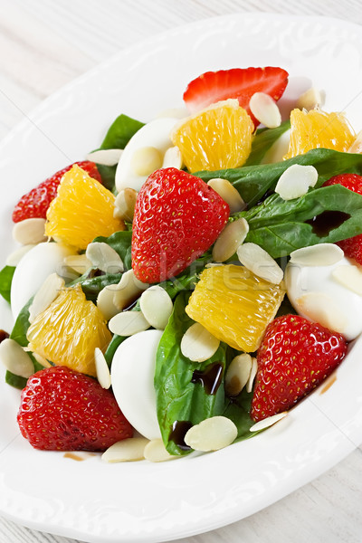 Spinach strawberry orange quail eggs salad with almonds slices Stock photo © IngridsI