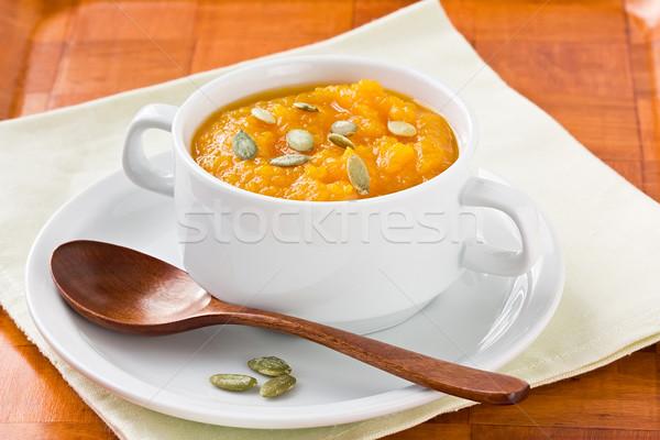 Pompoen soep zaden honing witte kom Stockfoto © IngridsI
