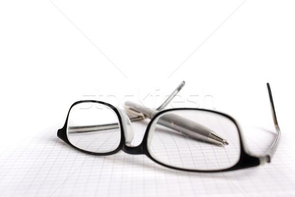 Szemüveg toll papír munka üzletember menedzser Stock fotó © inoj