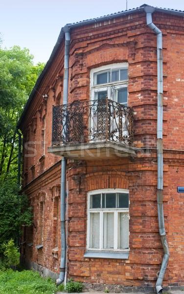 старые красный кирпичных здании дерево домой Сток-фото © inoj